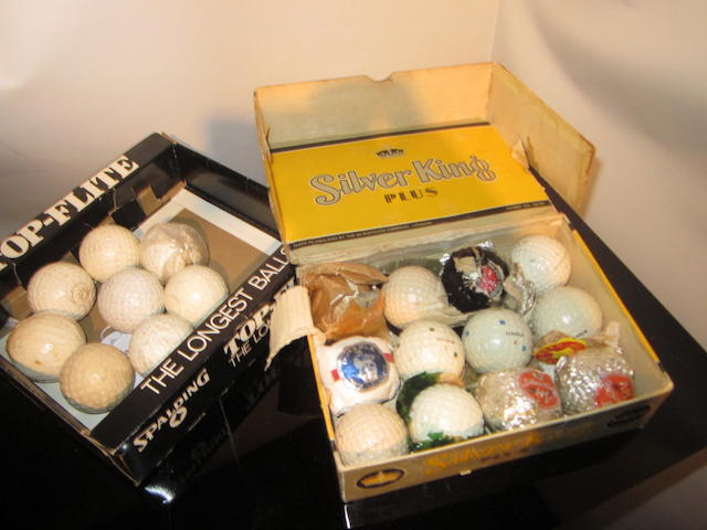 A grouping of 14 mesh patterned rubber-cored golf balls