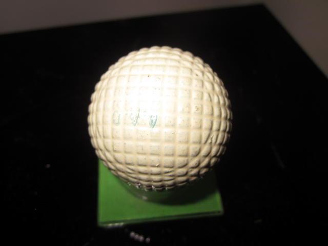 A mint moulded mesh gutta-percha cream-white painted golf ball