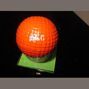 A near mint moulded mesh gutta-percha red painted Currie Eclipse golf ball