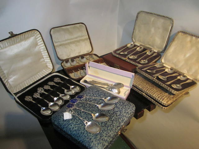 A collection of silver golfing spoons in fine condition