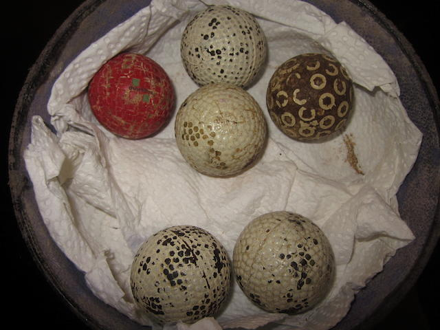 A collection of 5 bramble patterned golf balls