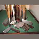 A collection of 28 mainly wooden shafted irons and putters