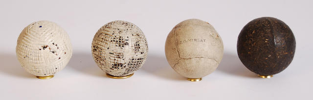A large smooth heavy dark brown gutty ball circa 1850