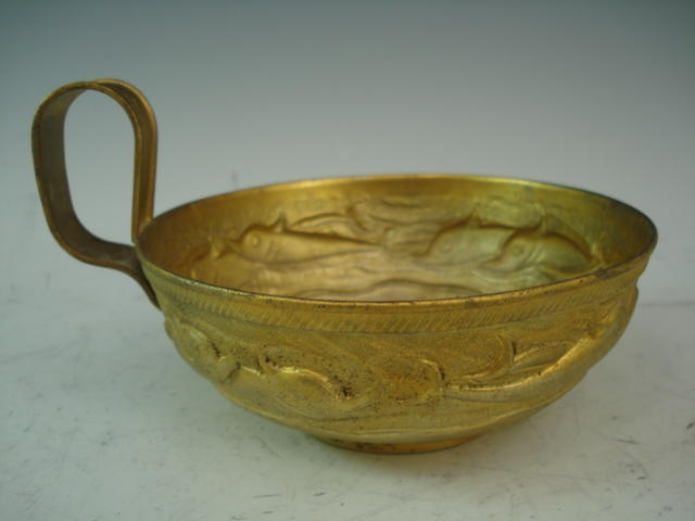 A Greek silver gilt embossed cup by Lalaounis, marked 900,