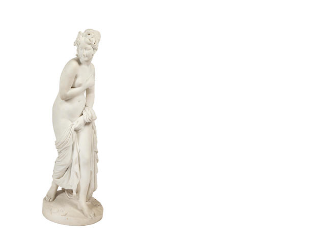 A 19th Century white Carrara marble figure of a young girl