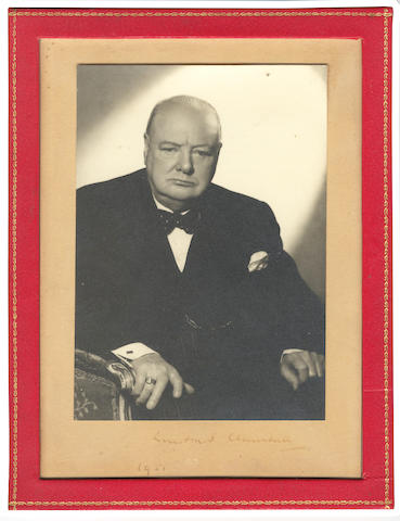 "CHURCHILL (WINSTON) Photograph signed an dated on mount (""Winston S. Churchill/ 1951""), showing Churchill half-length seated in a bergère, 1951"