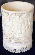 A 19th century Chinese carved ivory brush pot decorated with figures in formal garden setting,13cm high, together with a chinese silver metal dragon-embossed box, signed, 16.5cm wide, acarved soapstone figure 15cm high and a porcelain figure of a woman 20.5cm high.(4)