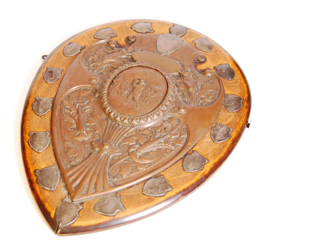 The Golfers' Club: a large copper on wood golfing shield trophy circa 1910