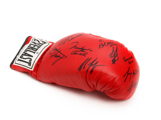 A boxing glove hand signed by 9 former heavyweight world champions