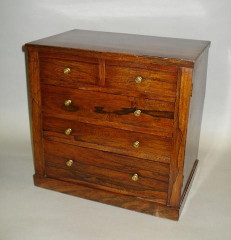 An unusual William IV Rosewood miniature wellington chest