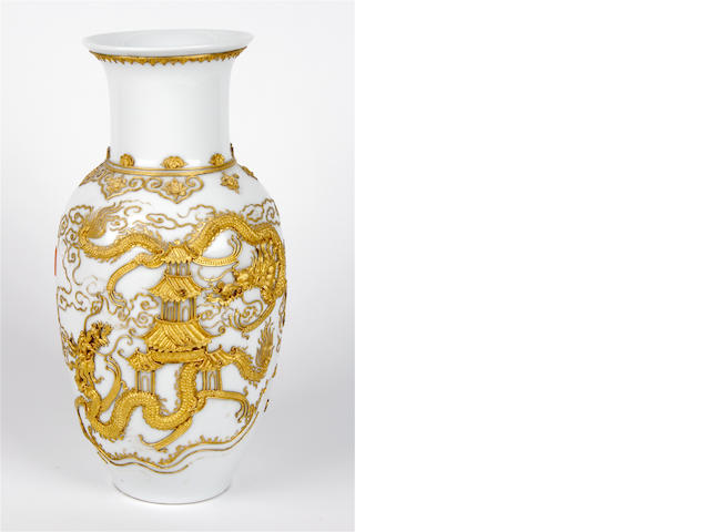 A Chinese porcelain vase with applied gilt decoration