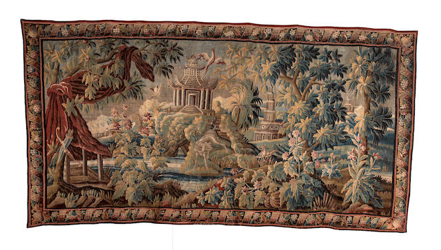 An early 18th century Flemish verdure tapestry, circa 1700, approx 532cm x 268cm