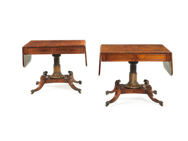 A pair of Regency rosewood, satinwood banded ebonised and parcel gilt sofa tables