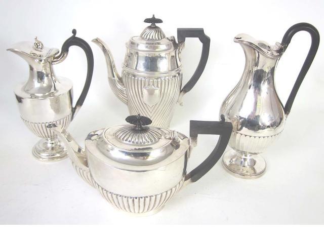 A matched silver three-piece tea service By Walter & John Barnard, London 1893, the teapot, Birmingham 1908  (7)