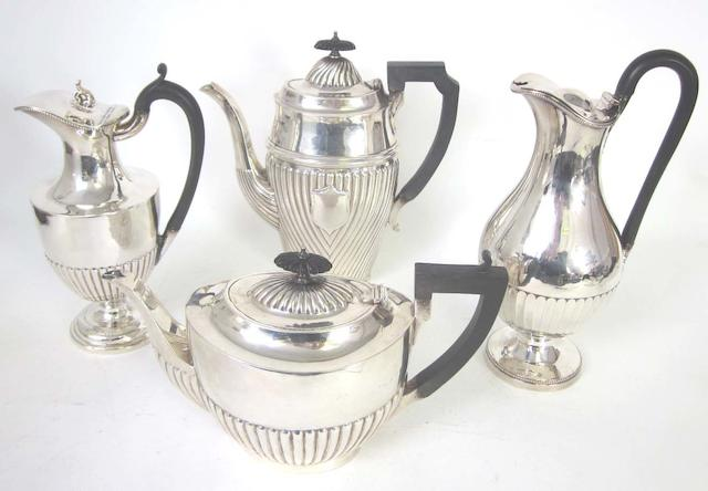 A matched silver three-piece tea service By Walter & John Barnard, London 1893, the teapot, Birmingham 1908  (7)