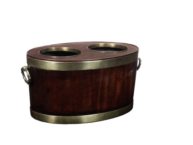 A George III mahogany and brass bound  wine cooler