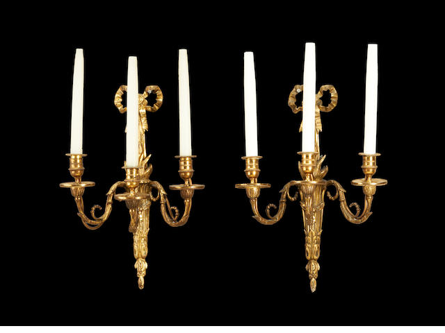 A pair of late 19th century Louis XVI style gilt metal wall lights
