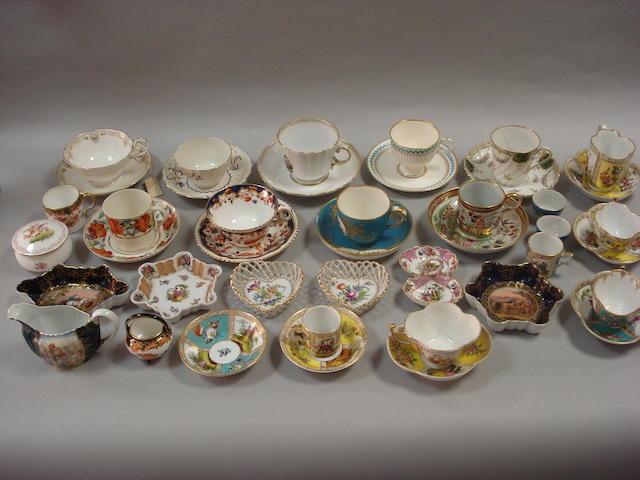 A small collection of cabinet cups and saucers, coffee cans and tea bowls,