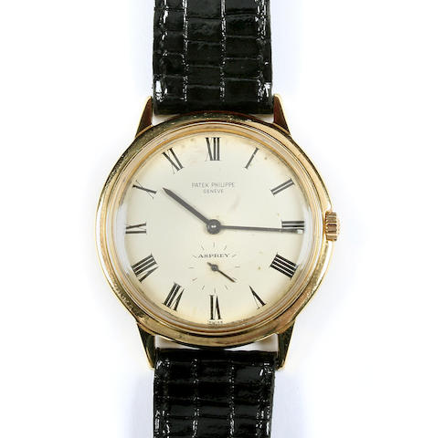 A Patek Philippe gold watch presented to Johnny Haynes by Fulham F.C., presentation book and photographs