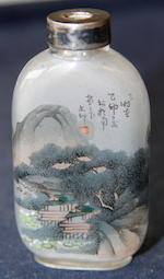 A Chinese glass inside painted snuff bottle decorated with a fisherman in a lakelandscape, with motto and green jade lid 7cm high, together with a carved amethyst glass snuff bottle 5cm high. (2)