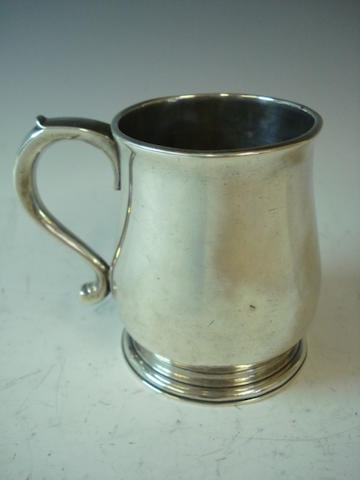 A George II silver half pint mug probably by John Fawdery, London 1729