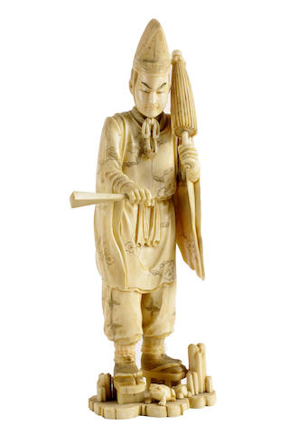 A Japanese carved sectional ivory okimono of a Shinto priest, signed Mitsukazu, Meiji period