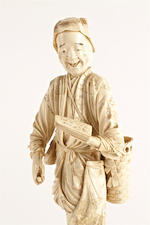 A Japanese carved sectional ivory okimono of a man, signed Masatomo, Meiji period,