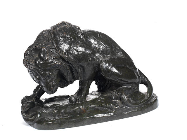 After Antoine Louis Barye (French, 1795-1875) A late 19th / early 20th century bronze model of Lion au Serpent (Lion des Tuileries)