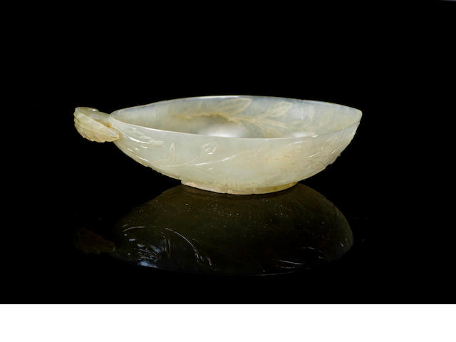 A Chinese Moghul style libation cup in pale celadon jade  18th century