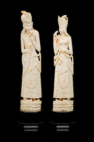 A pair of Indian carved ivory figures Early 20th century