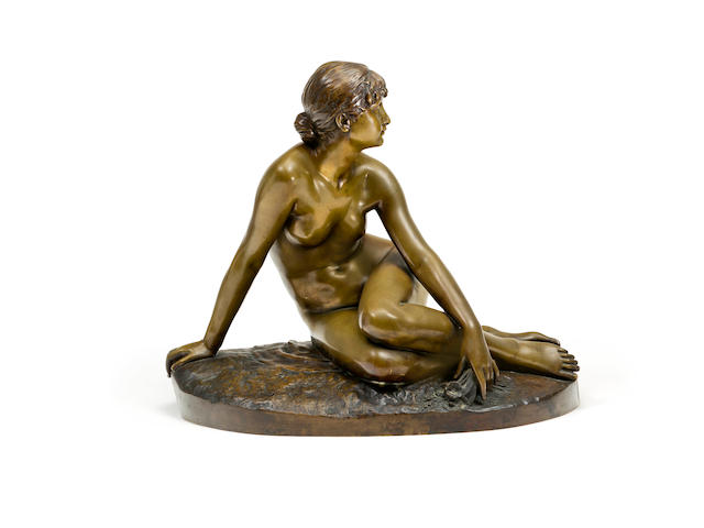 Peter Bruer (German 1856-1930)A bronze figure of a reclining figure 'Spring'