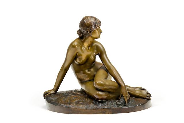 Peter Bruer (German 1856-1930)A bronze figure of a reclining figure 'Spring'
