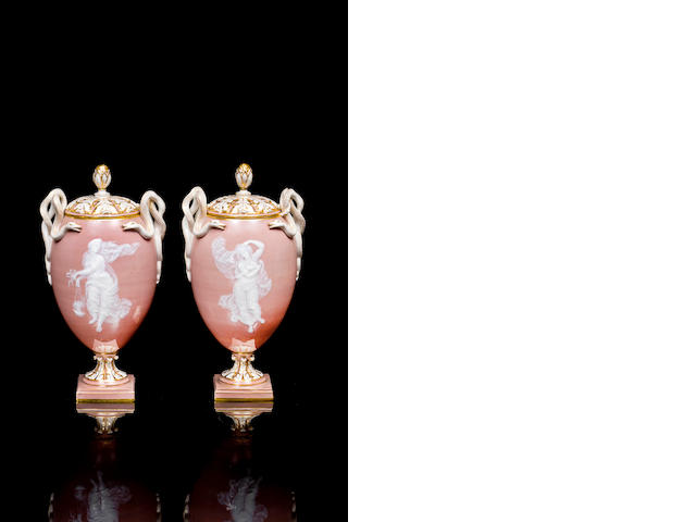 A pair of Meissen pâte-sur-pâte pedestal cameo vases and covers