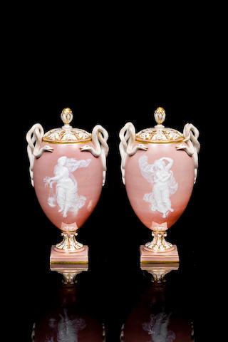 A pair of Meissen pâte-sur-pâte pedestal cameo vases and covers