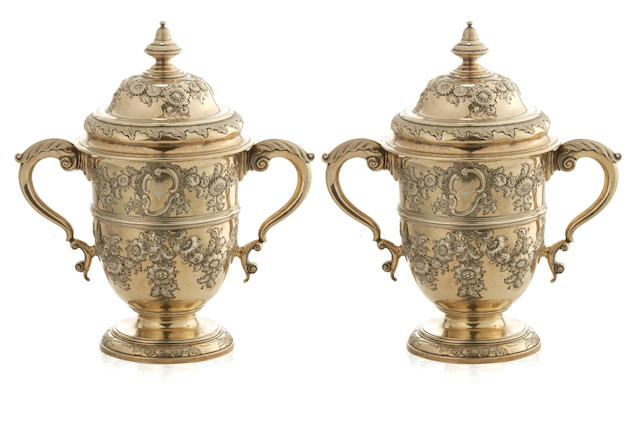 A pair of Victorian  silver gilt pedestal cache pots and covers  Messrs Barnard WBJ London 1895  (2)