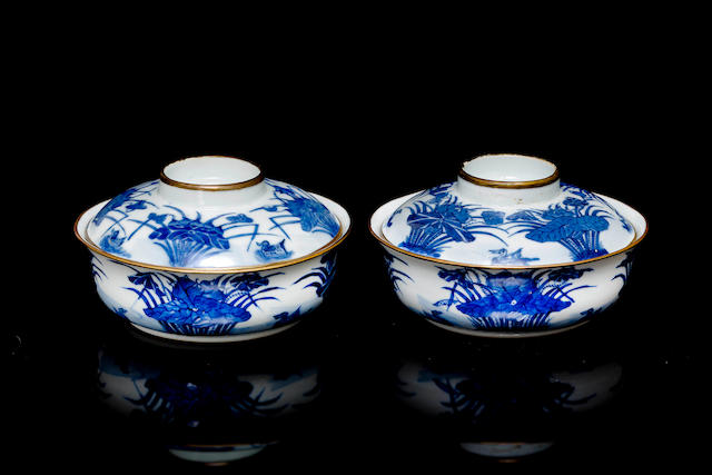 A pair of blue and white bowls and covers late 19th/ 20th century