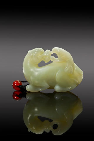 A carved celadon jade of a lion and a eagle 19th/ 20th century