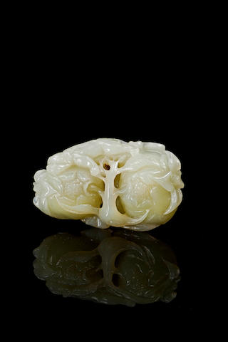 A carved celadon jade of pomegranates 19th/ 20th century