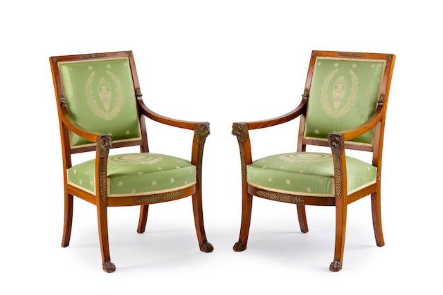 A pair of French early 19th century ormolu-mounted mahogany fauteuils