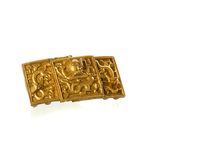 A Chinese buckle of gilded bronze 19th/ 20th century