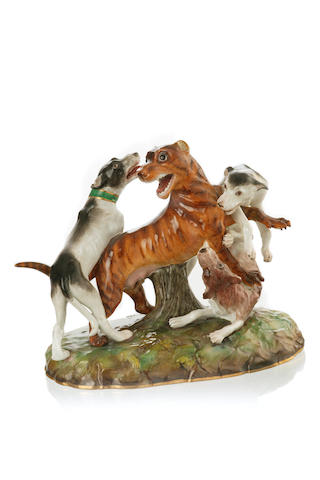 A German porcelain figure group of three dogs