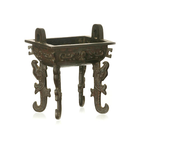 A Chinese bronze footed censer, ding
