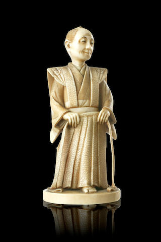 A Japanese carved ivory figure Meiji Period