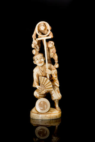 A Japanese carved ivory figure group Meiji Period
