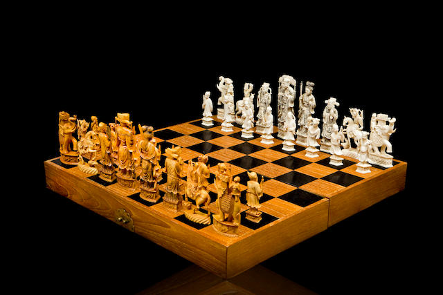 A Chinese boxed chess set in carved ivory 19th early 20th century