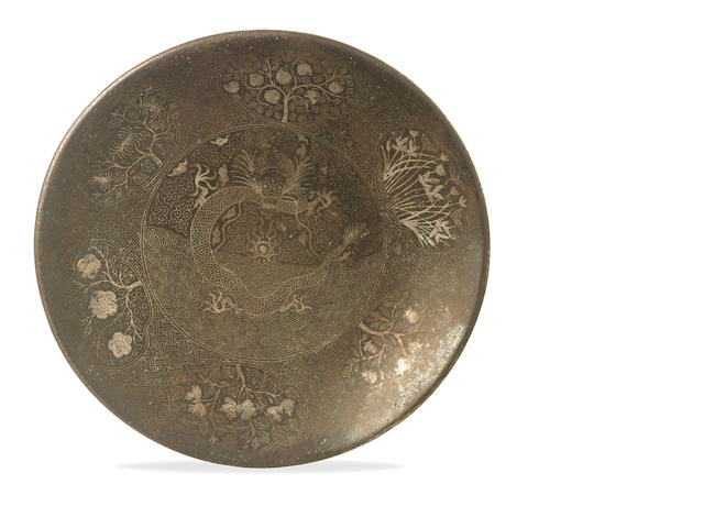 An iron plate with inlaid silver etching 19th/ 20th century