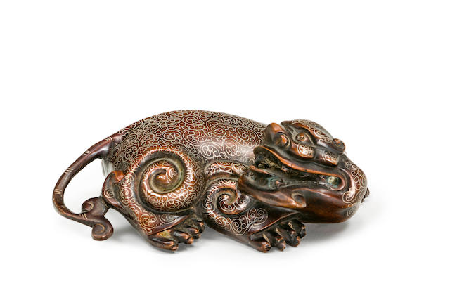 A Chinese silver inlaid bronze figure of a kylin 20th century