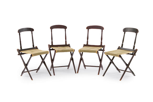Four Edwardian painted timber campaign chairs