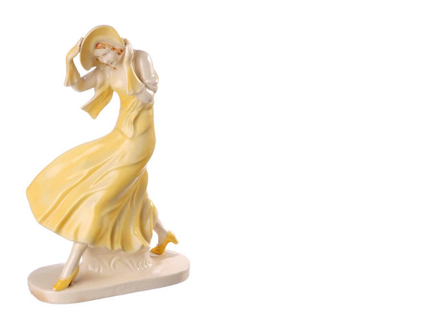 A German Art Deco figure of a woman battling the wind circa 1940