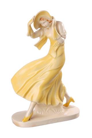 A German Art Deco figure of a woman battling the wind circa 1940